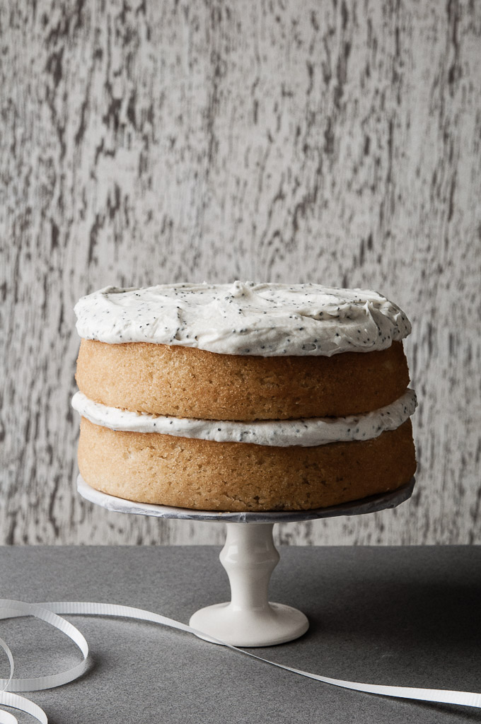 Lemon Velvet Cake with a Lemon Poppyseed Buttercream: a tart and sweet cake by ibakeheshoots.com
