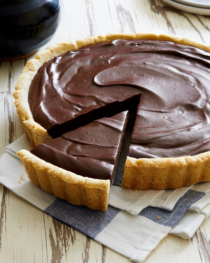 Impress your dinner guests with this easy and elagant dark chocolate lavender tart.| ibakeheshoots.com