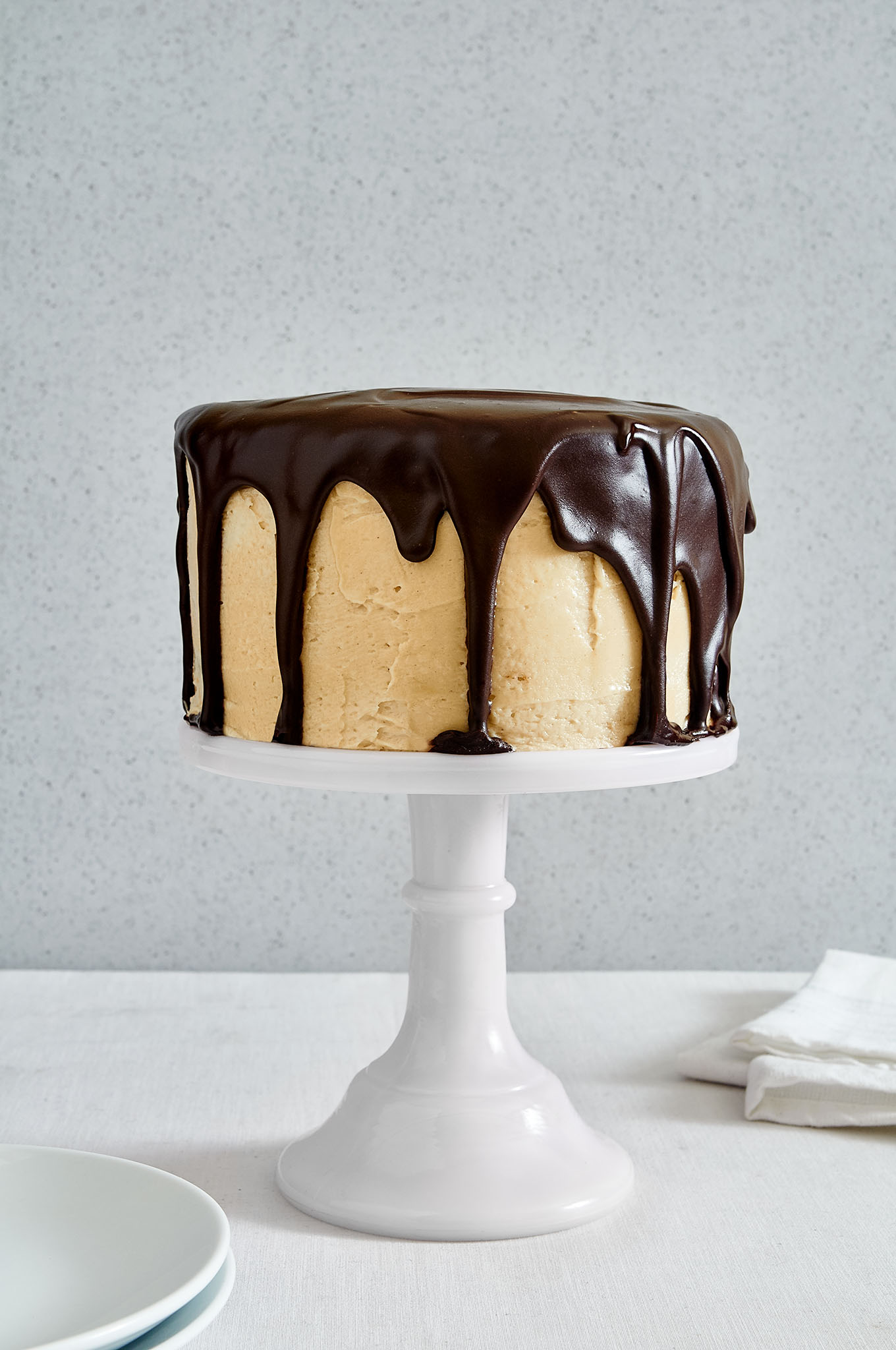 This triple layer chocolate peanut butter cake is so good, you'll go back for seconds and thirds | ibakeheshoots.com