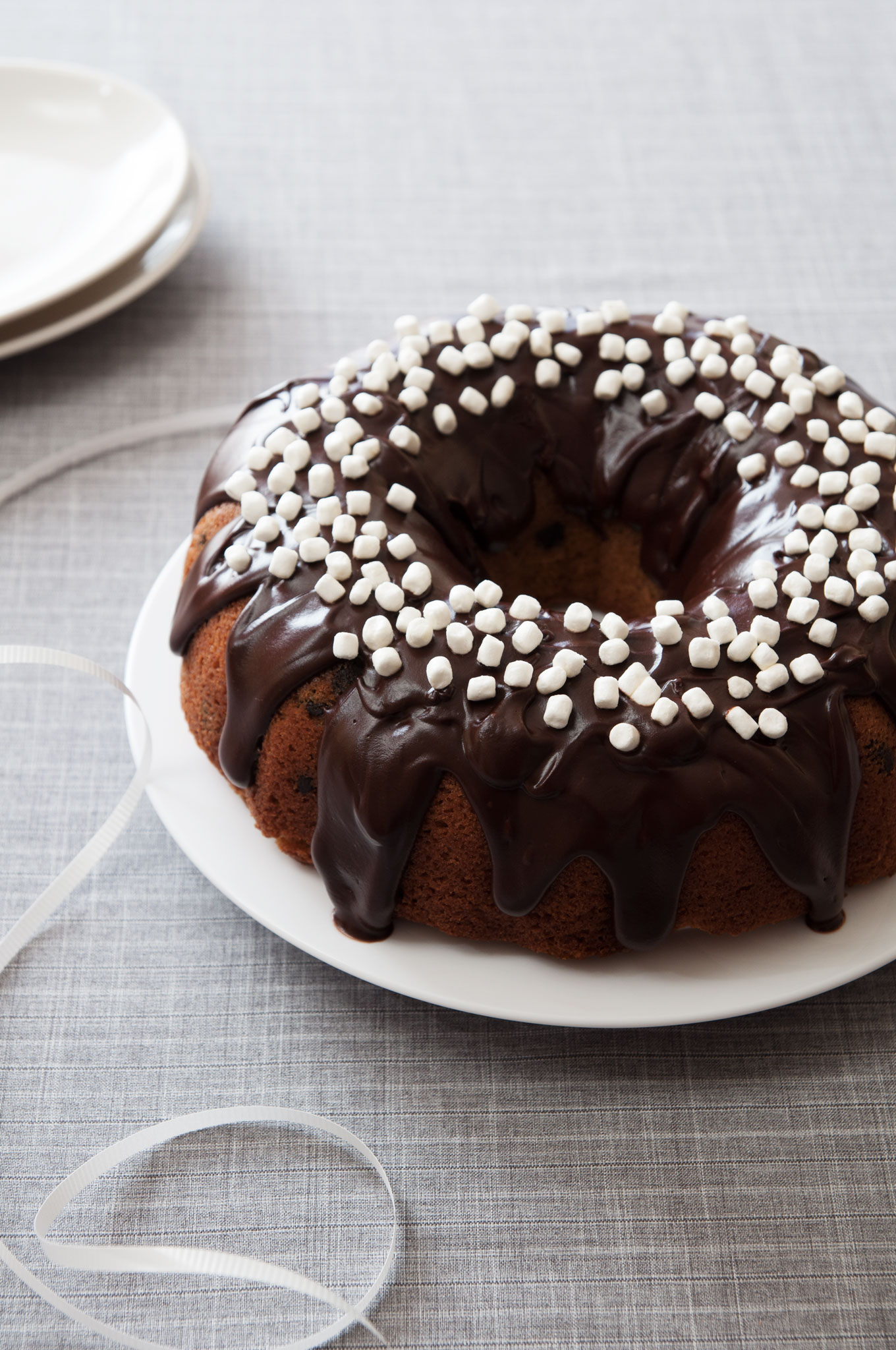 It's moist and made with graham crackers; this Nutella Glazed S'more Bundt Cake will not disappoint. | ibakeheshoots.com