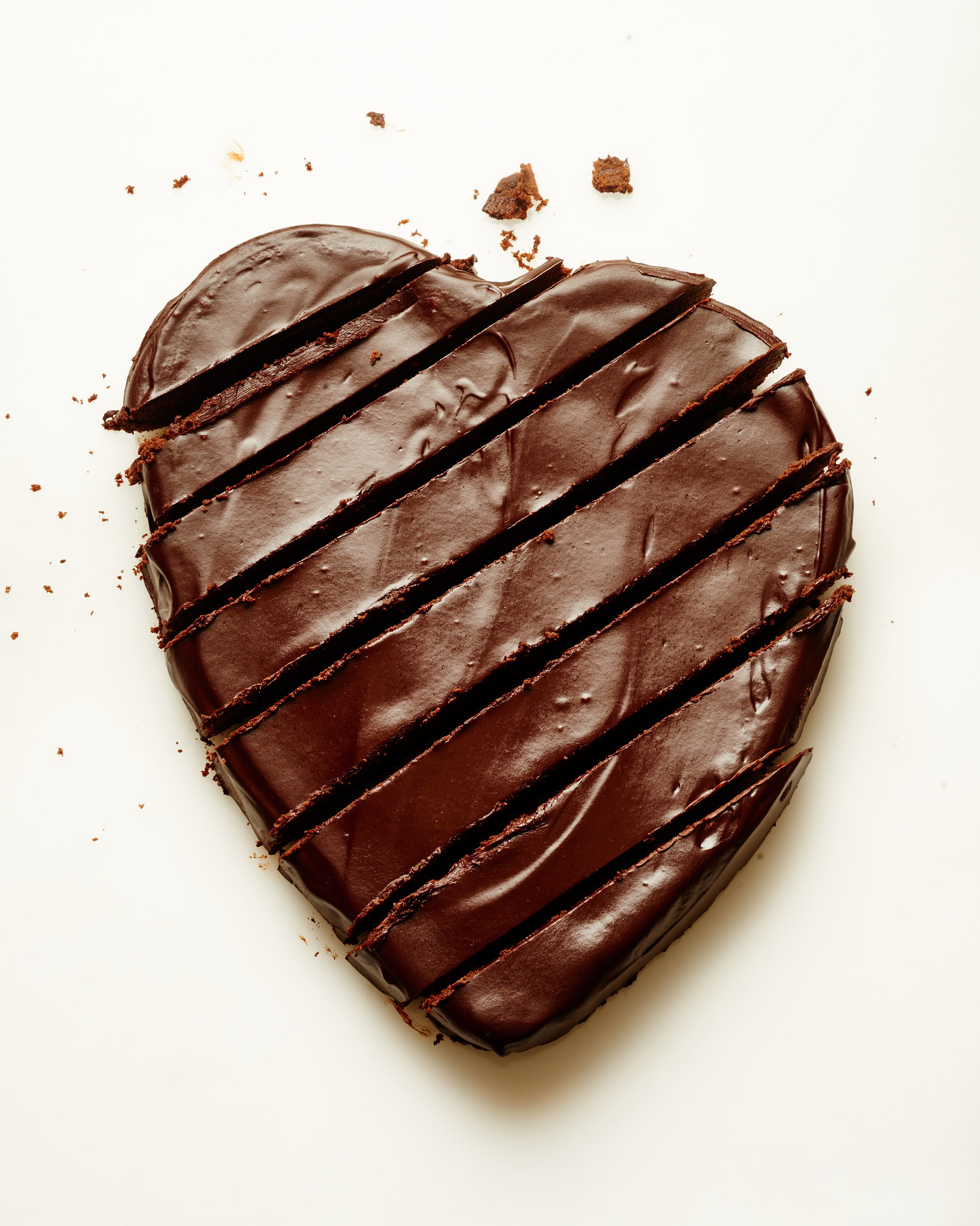 You and your chocoholic boyfriend will devour thisw Dark Chocolate Heart Cake with Red Wine Glaze on Valentine's Day. | ibakeheshoots.com